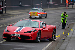 © Licensed to London News Pictures. 12/12/2016. London, UK. A police investigation team at the scene where six people have been rushed to hospital after a Ferrari sports car ploughed in to a group of pedestrians in Battersea, South London. Photo credit: Ben Cawthra/LNP
