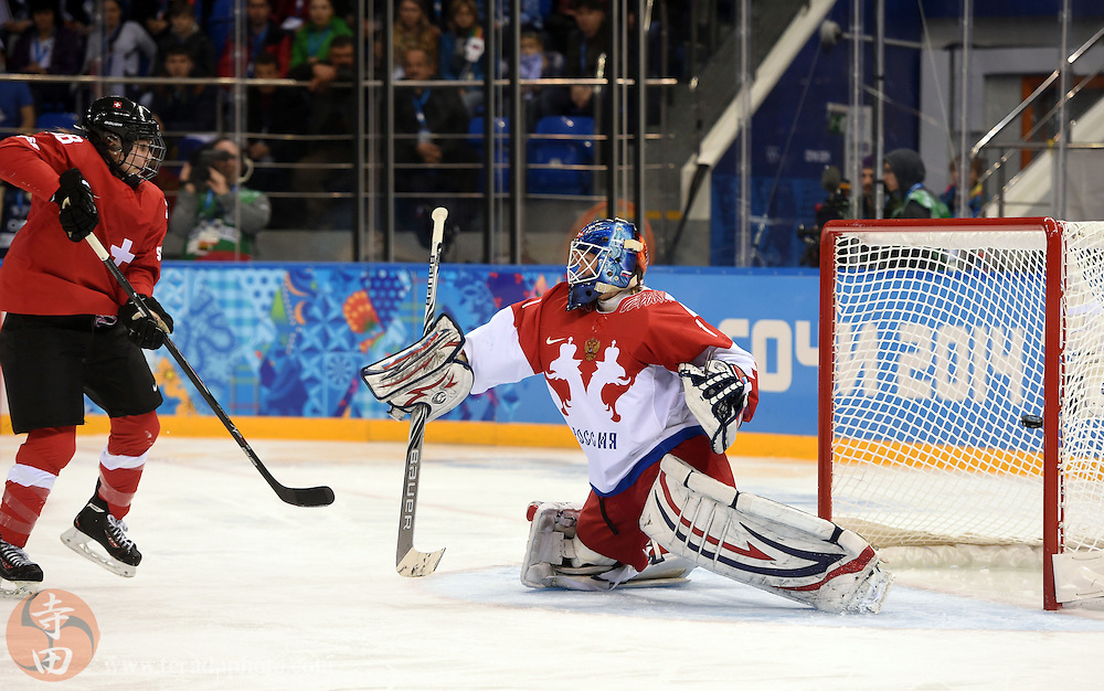 Feb 15, 2014; Sochi, RUSSIA; Switzerland forward Phoebe Stanz (88) looks at the net as Russia goalkeeper Anna Prugova (1) gives up a goal in a women's quarterfinals ice hockey game during the Sochi 2014 Olympic Winter Games at Shayba Arena.