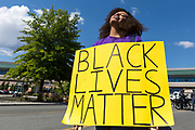 Reno resident, MEGAN LEWIS, holds a Black Lives Matter sign during a President Trump protest near the Reno-Sparks Convention Center on E Peckham Ln, in Reno, Nevada, on Wednesday, August 23, 2017.<br /> <br /> A group of approximately 200 protesters gathered near the convention center as President Trump was inside speaking to American Legion convention attendees.<br /> <br /> Lewis stated, &quot;I am Nevada born. I don't want Donald Trump in my state. I am genuinely scared for my country and for my black community. I am terrified. I am an American.&quot;