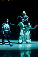 KELOWNA, CANADA - OCTOBER 21: The Pepsi player of the game lines up alongside James Porter #1 of the Kelowna Rockets against the Portland Winterhawks on October 21, 2017 at Prospera Place in Kelowna, British Columbia, Canada.  (Photo by Marissa Baecker/Shoot the Breeze)  *** Local Caption ***