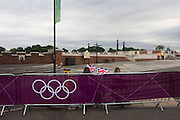 The first spectators guard their preferred location on the first day of competition of the London 2012 Olympic 250km mens' road race starting from central London and passing the capital's famous landmarks before heading out into rural England to the gruelling Box Hill in the county of Surrey. Local southwest Londoners lined the route hoping for British favourite Mark Cavendish to win Team GB first medal but were eventually disappointed when Kazakhstan's Alexandre Vinokourov eventually won gold.