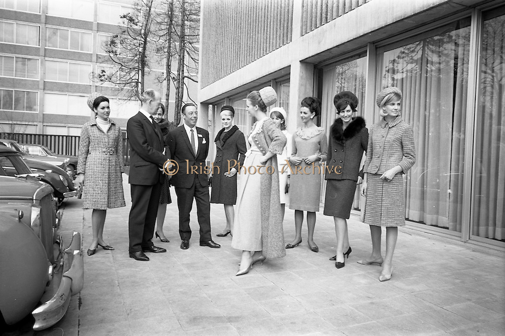 05/04/1965<br /> 04/05/1965<br /> 05 April 1965<br /> Second Irish Export Fashion Fair opened at the Intercontinental Hotel, Dublin. Picture shows (l-r):  Mr J.C.B. McCarthy, (left) Secretary, Department of Industry and Commerce, who opened the fair and Mr. W.H. Walsh, General Manager of Coras Trachtala chatting with some of the models who were taking part in the Fair's fashion parades.