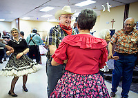 "Al Waskowiak, in hat, square dances with others during a ""Classic Cowboy"" themed senior citizens prom Thursday afternoon at the Grand Generation Center in Grand Island. (Independent/Matt Dixon)"