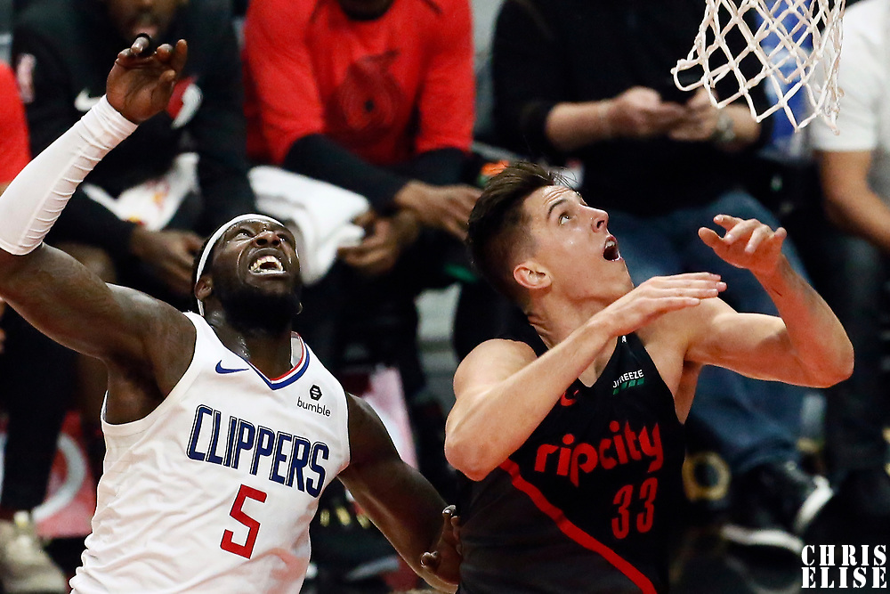 LOS ANGELES, CA - DEC 17: Montrezl Harrell (5) of the LA Clippers fights for position with Zach Collins (33) of the Portland Trail Blazers during a game on December 17, 2018 at the Staples Center in Los Angeles, California.