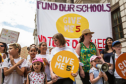 London, UK. 5 July, 2019. Jess Phillips, Labour MP for Birmingham Yardley, joins hundreds of parents and children marching with the Save Our Schools campaign group from Parliament Square to Downing Street in protest against schools being forced to close early on Fridays due to funding cuts and to highlight the government's responsibility to care for and educate the nation's children on Friday afternoons.