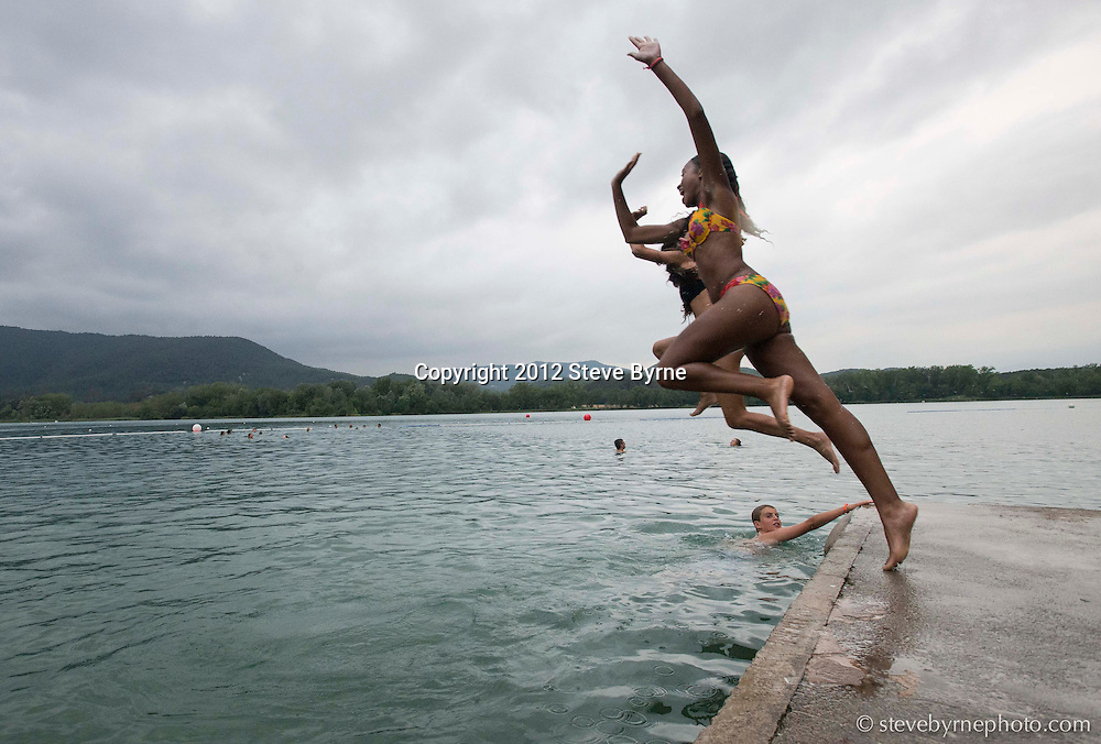 After shooting for the day in Girona and Besalu, student cool off in Banyoles Lake.  Banyoles, Catalonia, Spain.