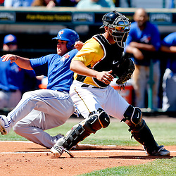 Mar 13, 2013; Bradenton, FL, USA; Toronto Blue Jays base runner Sean Ochinko slides home past Pittsburgh Pirates catcher James McDonald during the top of the sixth inning of a spring training game at McKechnie Field. Mandatory Credit: Derick E. Hingle-USA TODAY Sports