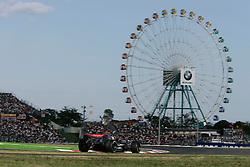 FORMEL 1: GP von Japan, Suzuka, 08.10.2006<br /> Rennstrecke, Kimi Raeikkoenen (FIN, McLaren Mercedes), Illustration, Riesenrad<br /> © pixathlon