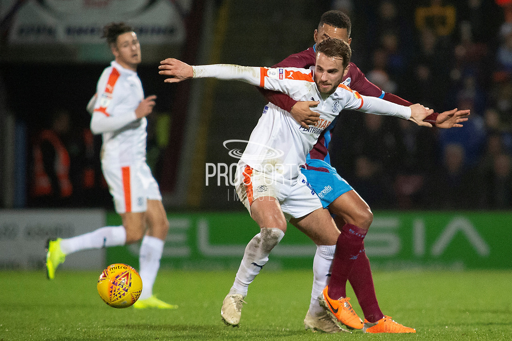 Luton Town midfielder Andrew Shinnie is fouled by Scunthorpe United midfielder Funso Ojo during the EFL Sky Bet League 1 match between Scunthorpe United and Luton Town at Glanford Park, Scunthorpe, England on 26 December 2018.