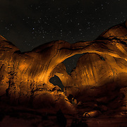 I was out taking photographs of the stars in Arches National Park, Utah, when I chanced upon a group of people lighting up Double Arch with torches and taking pictures of it. Very kindly they let me join for a few minutes.