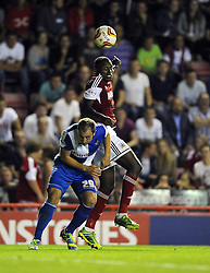 Bristol City's Jay Emmanuel-Thomas battles for the high ball with Bristol Rovers' Mark McChrystal  - Photo mandatory by-line: Joe Meredith/JMP - Tel: Mobile: 07966 386802 04/09/2013 - SPORT - FOOTBALL -  Ashton Gate - Bristol - Bristol City V Bristol Rovers - Johnstone Paint Trophy - First Round - Bristol Derby