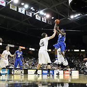 Memphis guard Will Barton (5) shoots over Central Florida forward A.J. Tyler (25) during a Conference USA NCAA basketball game between the Memphis Tigers and the Central Florida Knights at the UCF Arena on February 9, 2011 in Orlando, Florida. Memphis won the game 63-62. (AP Photo: Alex Menendez)