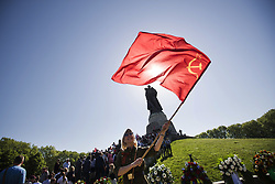 May 9, 2018 - Berlin, Germany - A woman waves a soviet red flag to commemorate on the 73rd anniversary of the victory of the Soviet Red Army over Nazi Germany at the Soviet World War II cemetery and memorial in Treptow on May 9, 2018 in Berlin, Germany. (Credit Image: © Emmanuele Contini/NurPhoto via ZUMA Press)