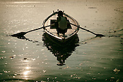 Silhouette of a boatman at Ganges River of Varanasi in India