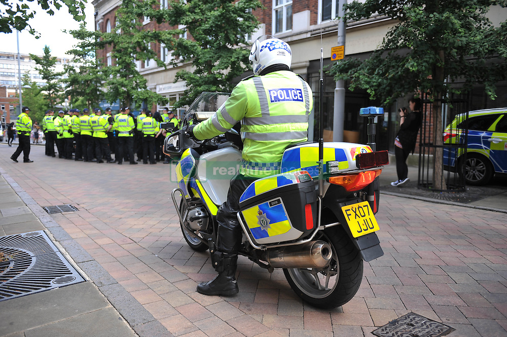 Members of the Nottingham Anti-Fascism group are cordoned off by police as protesters from the far-right group EDL (English Defence League) gather in the city of Nottingham. Nottinghamshire Police cordoned off city centre streets as the group made their way from Castle Wharf to the city centre.