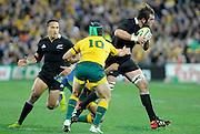 Sam Whitelock trys to bust the tackle of Berrick Barnes, Rugby Championship. Australia v All Blacks at ANZ Stadium, Sydney, New Zealand. Saturday 18 August 2012. New Zealand. Photo: Richard Hood/photosport.co.nz