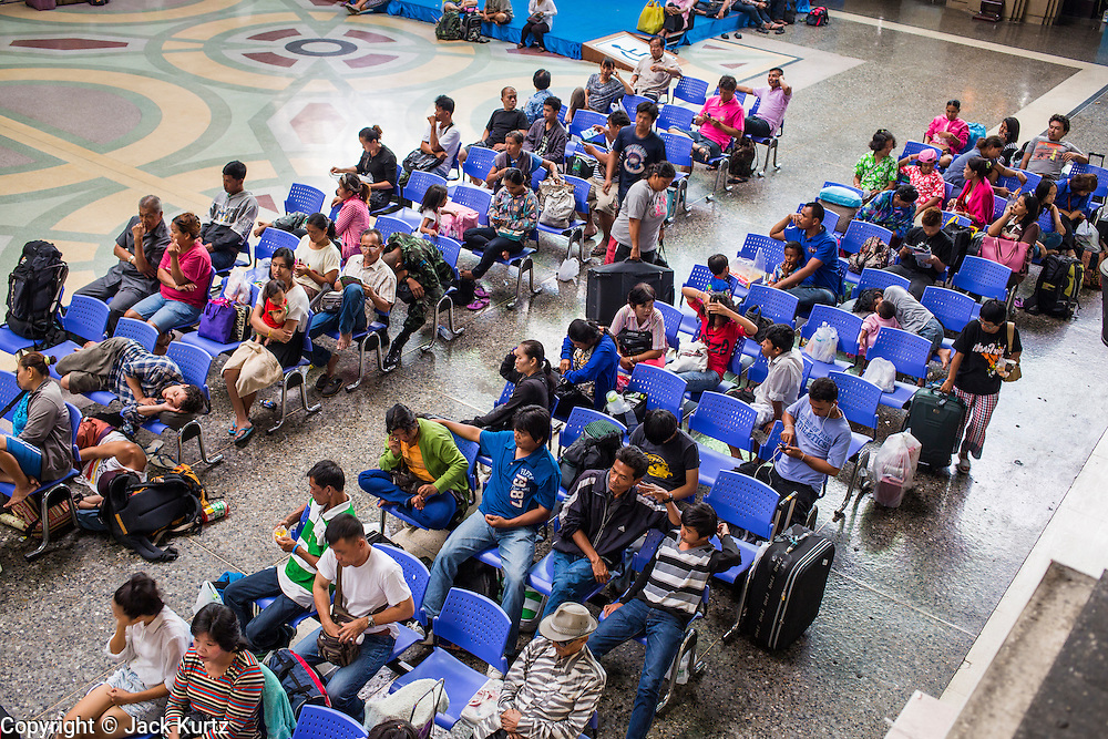 17 APRIL 2013 - BANGKOK, THAILAND:  Travelers in the main hall in Hua Lamphong Train Station in Bangkok. Songkran, the traditional Thai New Year, is the busiest time of the year for Thai domestic travel. Many people in Bangkok return to their home provinces for the holiday and some people in the provinces travel to Bangkok for the holiday. Songkran, usually a three day holiday, was five days this year because the official days on the weekend. Trains and buses coming into Bangkok were reported to be fully booked and the State Railway of Thailand added extra trains and carriages to accommodate the crowds.   PHOTO BY JACK KURTZ