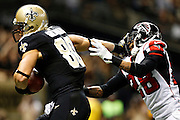 NEW ORLEANS, LA - NOVEMBER 11:  Jimmy Graham #80 of the New Orleans Saints stiff arms Thomas DeCoud #28 of the Atlanta Falcons on his way for a touchdown at Mercedes-Benz Superdome on November 11, 2012 in New Orleans, Louisiana.  The Saints defeated the Falcons 31-27.  (Photo by Wesley Hitt/Getty Images) *** Local Caption *** Jimmy Graham; Thomas DeCoud