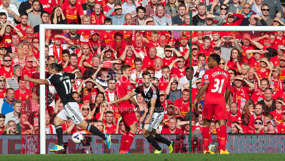 LIVERPOOL, ENGLAND - Saturday, September 21, 2013: Liverpool's captain Steven Gerrard looks dejected as Southampton score the winning goal during the Premiership match against Liverpool at Anfield. (Pic by David Rawcliffe/Propaganda)