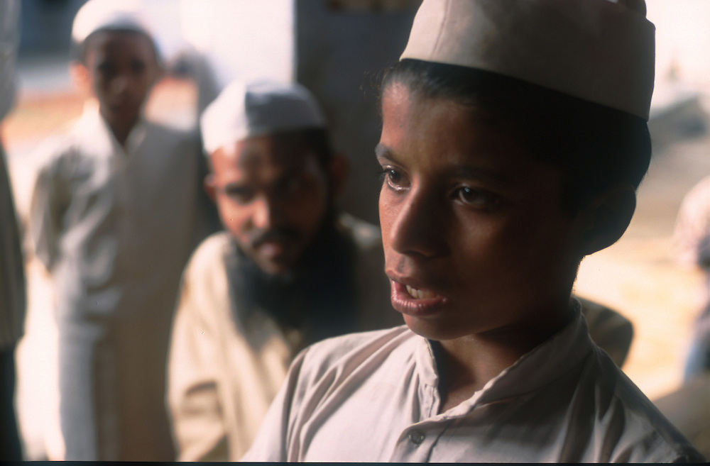 photo: Nadav Neuhaus.roots of the Taliban.India, October 2001..Behraich, Basti and Siddharthnagar are three districts of the Uttar Pradesh having international border with Nepal have a number of Madarsas..student taking an oral exam, reciting the Koran .