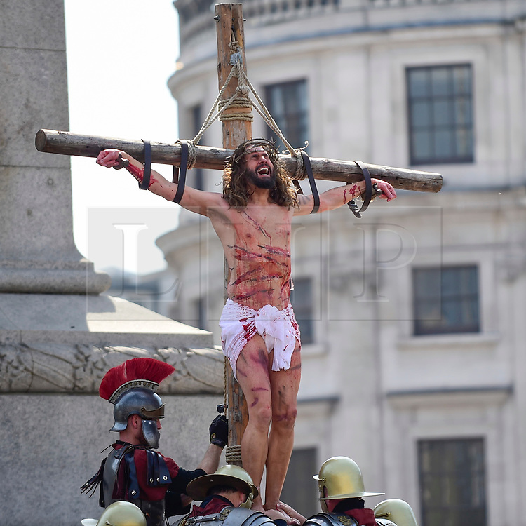 """© Licensed to London News Pictures. 19/04/2019. LONDON, UK.  Members of The Wintershall Players present their traditional """"The Passion of Jesus"""" play in Trafalgar Square on Good Friday in front of huge crowds.  The play brings to life the events leading to the crucifixion of Jesus Christ, played by James Burke-Dunsmore (pictured), and his subsequent resurrection.  Photo credit: Stephen Chung/LNP"""