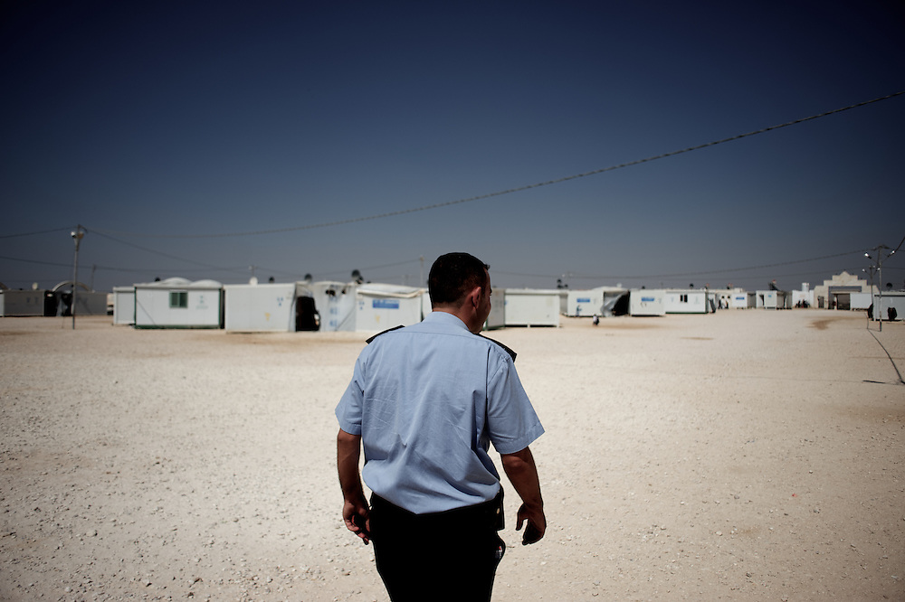 August 09, 2013 - Al-Ramthah, Jordan: A jordanian police man patrols Garden Village, a camp for syrian war refugees near Al-Ramthah city in northern Jordan. The camp opened in July 2012 and currently houses around 900 refugees. (Paulo Nunes dos Santos/Al Jazeera)