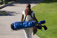 Woman Carrying Golf Club Bag
