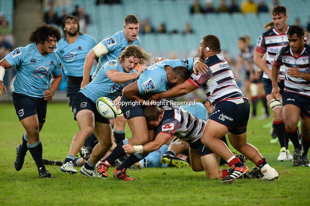 25.04.2015.  Sydney, Australia. Super Rugby. NSW Waratahs versus Melbourne Rebels. The Waratahs lose the ball under pressure. The Waratahs won 18-16.