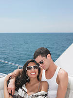 Young couple relaxing on yacht at sea