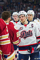 REGINA, SK - MAY 27:  Sam Steel #23 of Regina Pats leads the hand shake with the Acadie-Bathurst Titan after the final game loss at Brandt Centre - Evraz Place on May 27, 2018 in Regina, Canada. (Photo by Marissa Baecker/CHL Images)