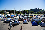 A general view of the site set up for football fans who had nowhere to stay but the tents, campervans, cars and caravans that they had bought with them. The site, at the Terreirao Do Samba, Rio de Janeiro, Brazil, was arranged by the city government once they realised the number of fans in this situation was significant and rather than having them scattered about the sity they offered secure, enclosed accommodation with sanitation and water. The majority of fans at the site were Argentinian but there were also people from Chile, USA, Uruguay and Colombia. <br /> Picture by Andrew Tobin/Focus Images Ltd +44 7710 761829<br /> 06/07/2014