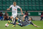 (L) Legia's Jakub Rzezniczak fights for the ball with (R) Apollon's Camel Meriem during the UEFA Europa League Group J football match between Legia Warsaw and Apollon Limassol FC at Pepsi Arena Stadium in Warsaw on October 03, 2013.<br /> <br /> Poland, Warsaw, October 03, 2013<br /> <br /> Picture also available in RAW (NEF) or TIFF format on special request.<br /> <br /> For editorial use only. Any commercial or promotional use requires permission.<br /> <br /> Mandatory credit:<br /> Photo by &copy; Adam Nurkiewicz / Mediasport