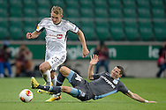 (L) Legia's Jakub Rzezniczak fights for the ball with (R) Apollon's Camel Meriem during the UEFA Europa League Group J football match between Legia Warsaw and Apollon Limassol FC at Pepsi Arena Stadium in Warsaw on October 03, 2013.<br /> <br /> Poland, Warsaw, October 03, 2013<br /> <br /> Picture also available in RAW (NEF) or TIFF format on special request.<br /> <br /> For editorial use only. Any commercial or promotional use requires permission.<br /> <br /> Mandatory credit:<br /> Photo by © Adam Nurkiewicz / Mediasport