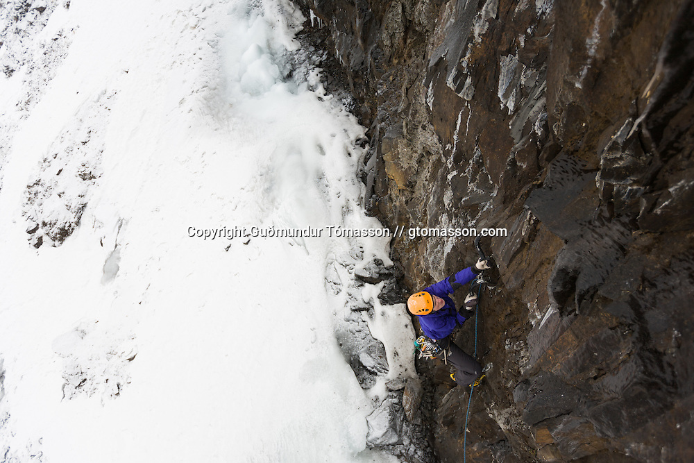 "Róbert Halldórsson on the first ascent of the ice climb "" Drög að sjálfsmorði"" M7, 35m, at Breiðdalur. East Iceland."