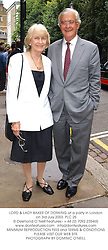 LORD & LADY BAKER OF DORKING at a party in London on 3rd July 2003.<br /> PLC 25