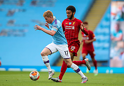 MANCHESTER, ENGLAND - Thursday, July 2, 2020: Manchester City's Kevin De Bruyne is chased down by Liverpool's Joe Gomez during the FA Premier League match between Manchester City FC and Liverpool FC at the City of Manchester Stadium. The game was played behind closed doors due to the UK government's social distancing laws during the Coronavirus COVID-19 Pandemic. This was Liverpool's first game as Premier League 2019/20 Champions. (Pic by Propaganda)