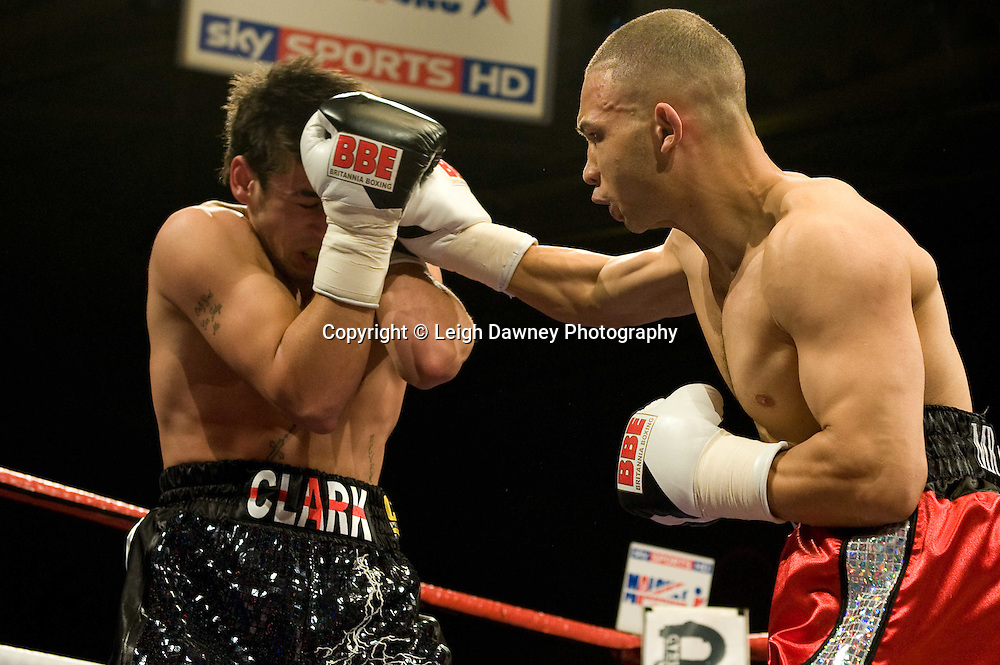 Curtis Valentine (red shorts) defeats Ryan Clark at the Harvey Hadden Leisure Centre 5th February 2010 Frank Maloney Promotions. Photo credit © Leigh Dawney