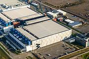 Nederland, Groningen, Eemshaven, 04-11-2018; Google datacentre. De servers hosten onder andere Gmail, Maps en YouTube. Rechts bedieningingsgebouw, met belettering.<br /> Google data center in the nearby Eemshaven.<br /> <br /> luchtfoto (toeslag op standaard tarieven);<br /> aerial photo (additional fee required);<br /> copyright&copy; foto/photo Siebe Swart