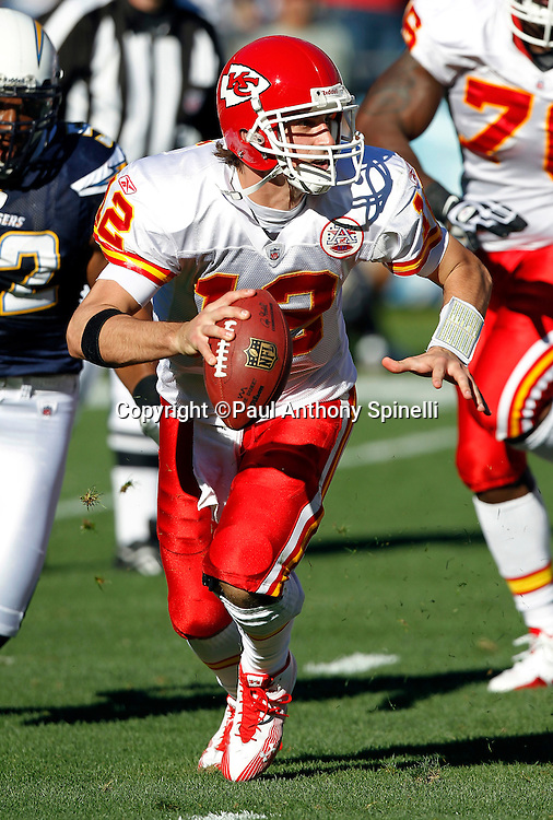 Kansas City Chiefs quarterback Brodie Croyle (12) runs away from pressure while looking to pass during the NFL week 14 football game against the San Diego Chargers on Sunday, December 12, 2010 in San Diego, California. The Chargers won the game 31-0. (©Paul Anthony Spinelli)