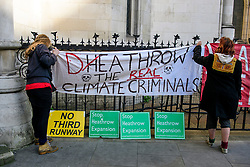 © Licensed to London News Pictures. 03/04/2017. London, UK. Campaigners for the group Grow Heathrow gather outside the Royal Courts of Justice in London where a court is due to hear an application to evict the group from a plot of land near Heathrow airport where they are campaigning against the building of a third runway.  Photo credit: Ben Cawthra/LNP