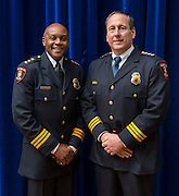 Retiring Houston ISD Chief of Police Jimmy Dotson, left, and incoming Chief of Police Robert Mock pose for a photograph before Mock's swearing-in ceremony, January 6, 2014, at the High School for Law Enforcement and Criminal Justice.