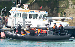 ©Licensed to London News Pictures 11/08/2020 Dover, UK. Migrants arriving at the port of Dover in a Border Force boat. Border Force officers have intercepted more migrants this morning trying to cross the English Channel from France. Photo credit: Grant Falvey/LNP
