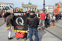 "29 AUG 2020, BERLIN/GERMANY:<br /> Demonstranten mit Plakat ""Compact - Q - Querdenker"" vor dem Brandenburger Tor, Demonstration gegen die Einschraenkungen in der Corona-Pandemie durch die Initiative ""Querdenken 711"" aus Stuttgart unter dem Motto ""invites Europa - Fest für Freiheit und Frieden"", Pariser Platz<br /> IMAGE: 20200829-01-001<br /> KEYWORDS: Demo, Protest, Demosntranten, Protester, COVID-19, Corona-Demo, Compact Magazin, QAnon"