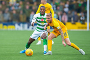 Robbie Crawford (#16) of Livingston FC gets to the ball ahead of Boli Bolingoli (#23) of Celtic FC during the Ladbrokes Scottish Premiership match between Livingston FC and Celtic FC at The Tony Macaroni Arena, Livingston, Scotland on 6 October 2019.