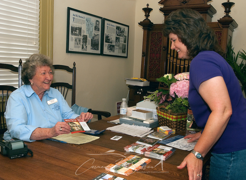 Virginia Thomas, manager of the Tennessee Williams Welcome Center in Columbus, Miss., sells tickets to the annual Spring Pilgrimage of Homes to Mary Beth Dilda April 17, 2010. (Photo by Carmen K. Sisson/Cloudybright)