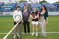 LIVERPOOL, ENGLAND - Saturday, June 18, 2011: Martina Hingis (SUI) and Chloe Murphy (GBR) with a sponsor before the Women's Final during day three of the Liverpool International Tennis Tournament at Calderstones Park. (Pic by David Rawcliffe/Propaganda)