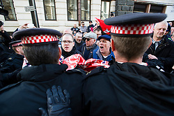 © London News Pictures. 26/02/2014. London, UK.  Supporteres of the BNP and other demonstrators clash with police as they vent their anger outside the Old Bailey in London where Michael Adebolajo and Michael Adebowale are due to be sentenced for the murder of Fusilier Lee Rigby who was attacked near Woolwich Barracks in south-east London on May 22, 2013. Photo credit: Ben Cawthra/LNP