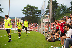 ZUG, SWITZERLAND - Wednesday, July 21, 2010: Liverpool supporters watch as the substitutes warm up during the Reds' first preseason match of the 2010/2011 season against Grasshopper Club Zurich at the Herti Stadium. (Pic by David Rawcliffe/Propaganda)