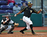 MANHATTAN, KS - APRIL 08:  Left fielder Kenny Williams Jr. of the Wichita State Wheat Shockers drives the ball up the middle against the Kansas State Wildcats at Tointon Stadium in Manhattan, Kansas.  Wichita State defeated Kansas State 4-3.  (Photo by Peter Aiken/Getty Images)