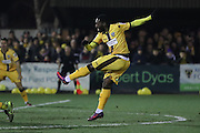 Sutton United Roarie Deacon (21) shoots at goal during the The FA Cup third round replay match between AFC Wimbledon and Sutton United at the Cherry Red Records Stadium, Kingston, England on 17 January 2017. Photo by Stuart Butcher.